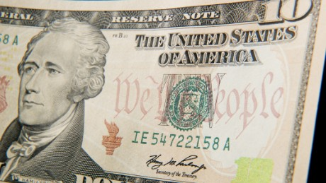 A close-up of the front of the US 10-dollar bill bearing the portrait of Alexander Hamilton, America's first Treasury Secretary, is seen on December 7, 2010 in Washington, DC. Various security features are imprinted into the bank note.  Different denomination security threads have various colors which are visible when lit by ultra-violet light. The security features found in United States currency are selected after extensive testing and evaluation of hundreds of bank note security devices, many of which are used successfully by other countries with lower production and circulation demands.   AFP PHOTO / Paul J. RICHARDS (Photo credit should read PAUL J. RICHARDS/AFP/Getty Images)
