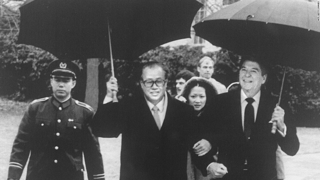 U.S. President Ronald Reagan and former Chinese Premier Zhao Ziyang walk arm in arm in the rain after a meeting at the White House in January, 1984. Zhao -- and Hu Yaobang, General Secretary of the Communist Party -- were the first Chinese leaders to wear a Western suit, during a period when China's reform and opening took off.