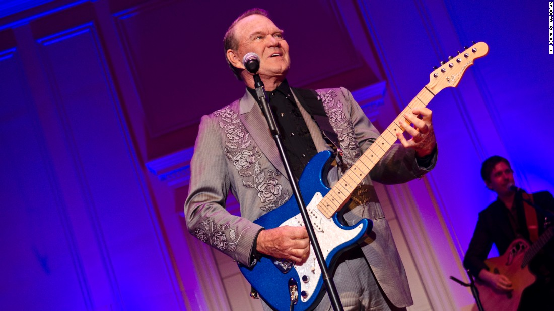 "Now in his 80s and afflicted with Alzheimer's disease, Campbell, had a final tour in 2012, pictured here. The tour is immortalized in the film, ""Glen Campbell: I'll Be Me."""