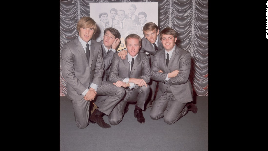 "The Beach Boys, photographed on November 2, 1964, in London. From left, Carl Wilson (1946 - 1998), Brian Wilson, Mike Love, Al Jardine and Dennis Wilson (1944 - 1983).  The pioneers of the California surf sound followed Farm Aid in 1988 with their first No. 1 hit in more than 20 years, ""Kokomo."""