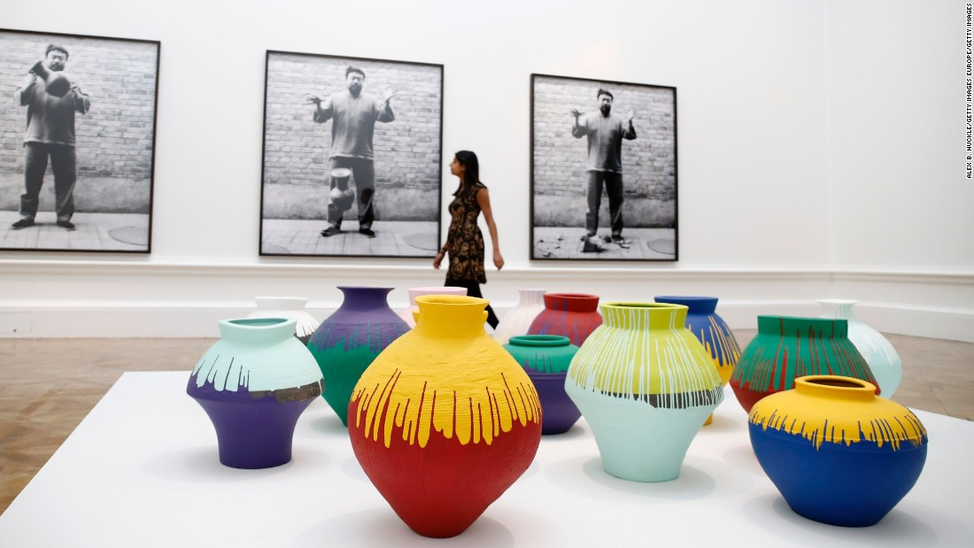 Back: <em>Dropping a Han Dynasty Urn</em>, 1995. Front: <em>Coloured Vases</em>, 2006<br />Neolithic vases (5000-3000 BC) painted by the artist with industrial paint. Ai's destruction or appropriation of ancient Chinese urns have been seen as provocative comments on the vandalism of ancient Chinese culture by the country's modern leaders.