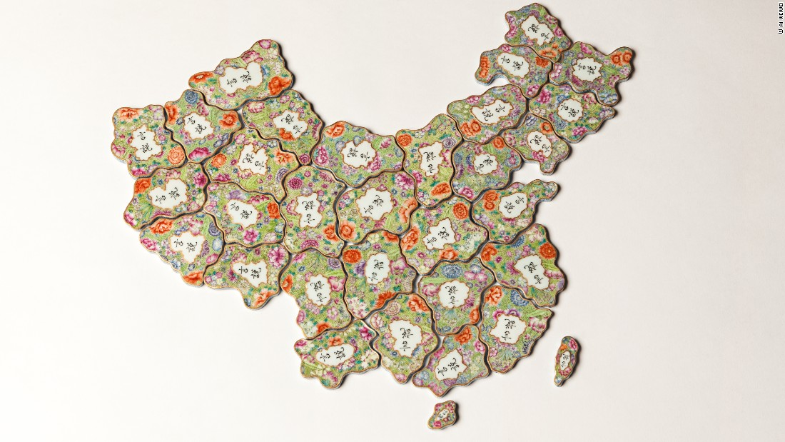 <em>Free Speech Puzzle</em>, 2014. 32 pieces of hand-painted porcelain in the Qing dynasty imperial style. The porcelain depicts China from replicas of traditional pendants which would depict a family's name and status.