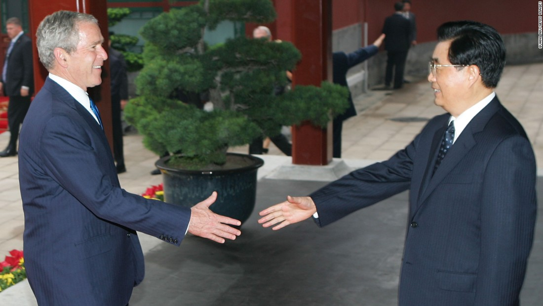 Former Chinese President Hu Jintao greets U.S. President George W. Bush in Beijing, China in August, 2008. Bush attended the opening ceremony of the 2008 Summer Olympics Games in Beijing during his trip to Asia that month.