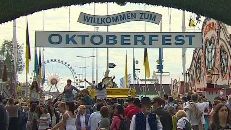 germany munich oktoberfest tourists refugees shubert pkg_00021129