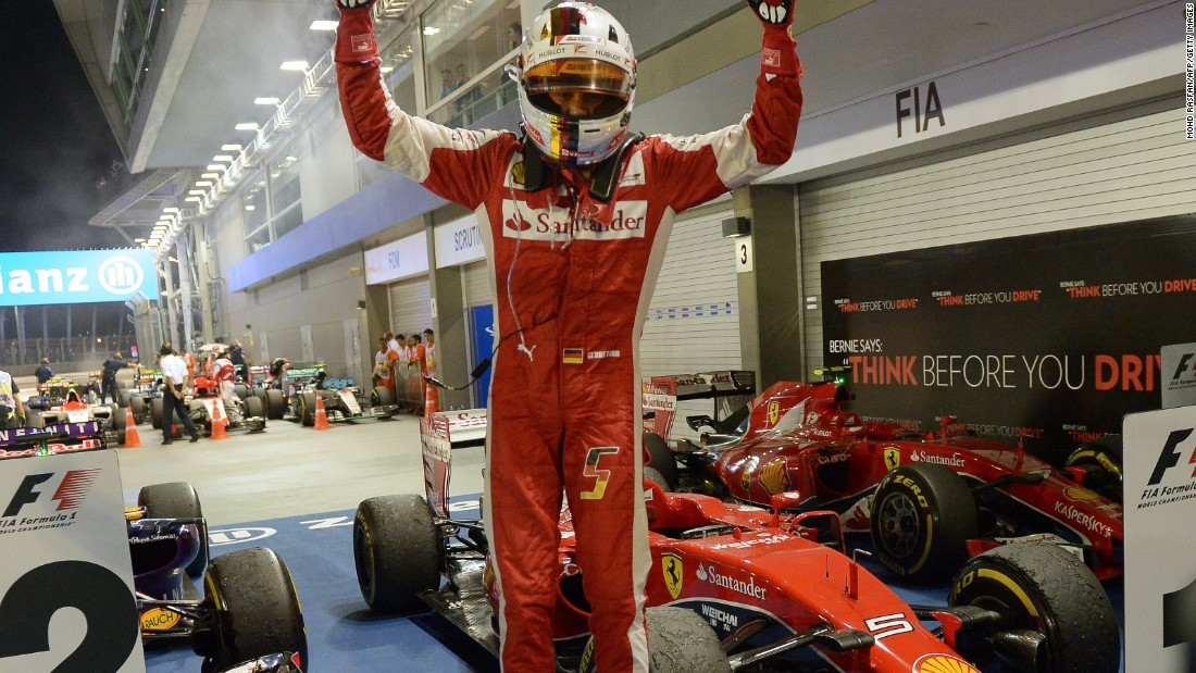Ferrari's Sebastian Vettel jumps for joy after claiming his 42nd career F1 victory in Singapore.