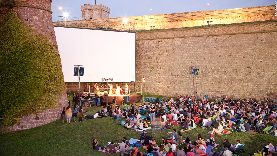 "Though this 17th century fortress has a dark past, <a href=""http://www.venuereport.com/roundups/22-incredible-outdoor-cinemas-worldwide/entry/7/"" target=""_blank"">Sala Montjuic</a> is one of the most successful examples of a castle that's been reclaimed for public use. Guests can bring picnic blankets and dinner as they take in both the screen and the sunset every Wednesday night."