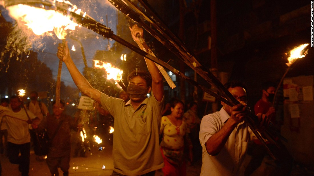 Nepalese activists from marginalized Tharu community take part in a torch rally against the division of Tharu-majority districts in the country's proposed federal structure in Kathmandu on August 11, 2015.