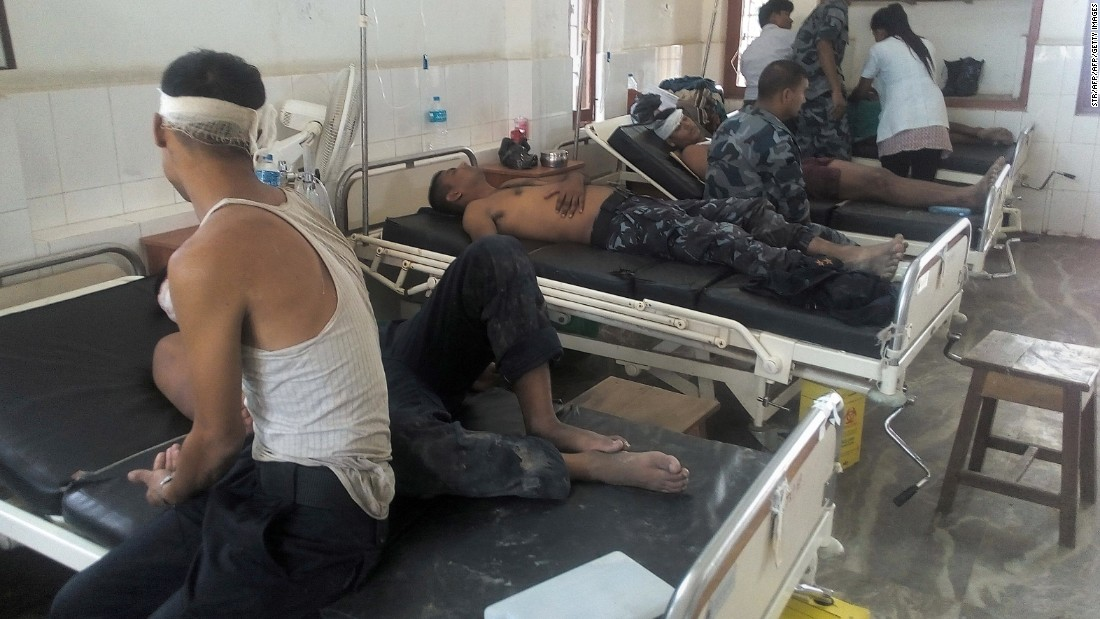 Nepalese law enforcement officers, who were injured in a deadly clash with protestors, receive treatment at Tikapur Hospital in Kailali District, some 420 kms west of capital Kathmandu on August 24, 2015.