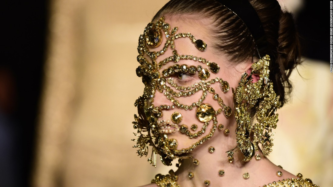 A model sporting a gold mask beauty look by visionary make up artist Pat McGrath.