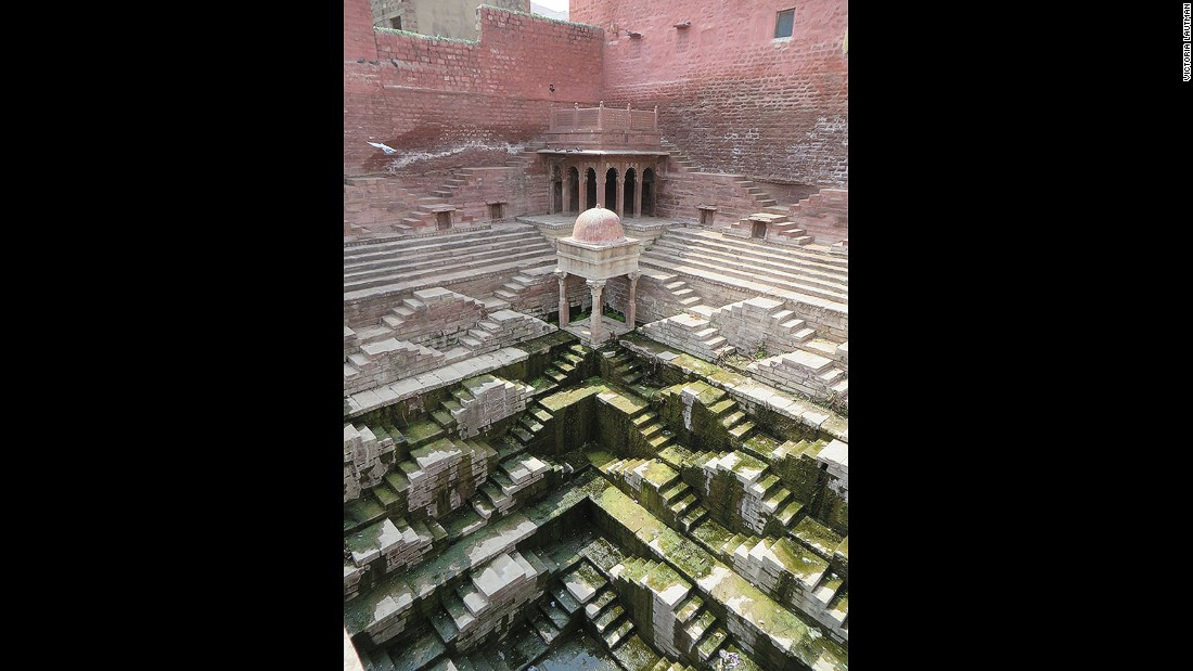 """This is another example of a kund, small but powerfully sculptural. The gradation of hues from pink to white to green (from algae) makes it one of the most colorful of all the stepwells I've visited, and it's a particular favorite."""