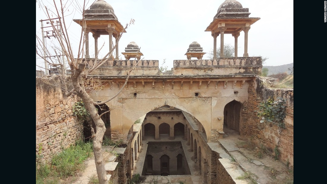 """It's not easy getting to this small stepwell in the fields outside the city of Narnaul, with its many spectacular Mughal monuments. But the dirt road eventually lead to pretty -- if overgrown -- stepwells, with its four chattris that come into view. What a peaceful spot in its day - I'm sorry this one's such a ruin."""