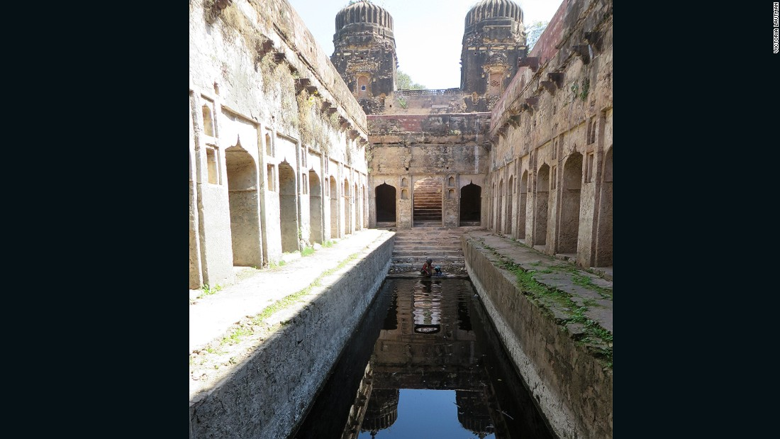 """A farm family cares for this stepwell, using it as it was in past centuries: for drinking, washing, and irrigation. It's large scale, huge entry towers, and architectural details make it another of my favorites -- an unexpected treasure way out in the countryside."""