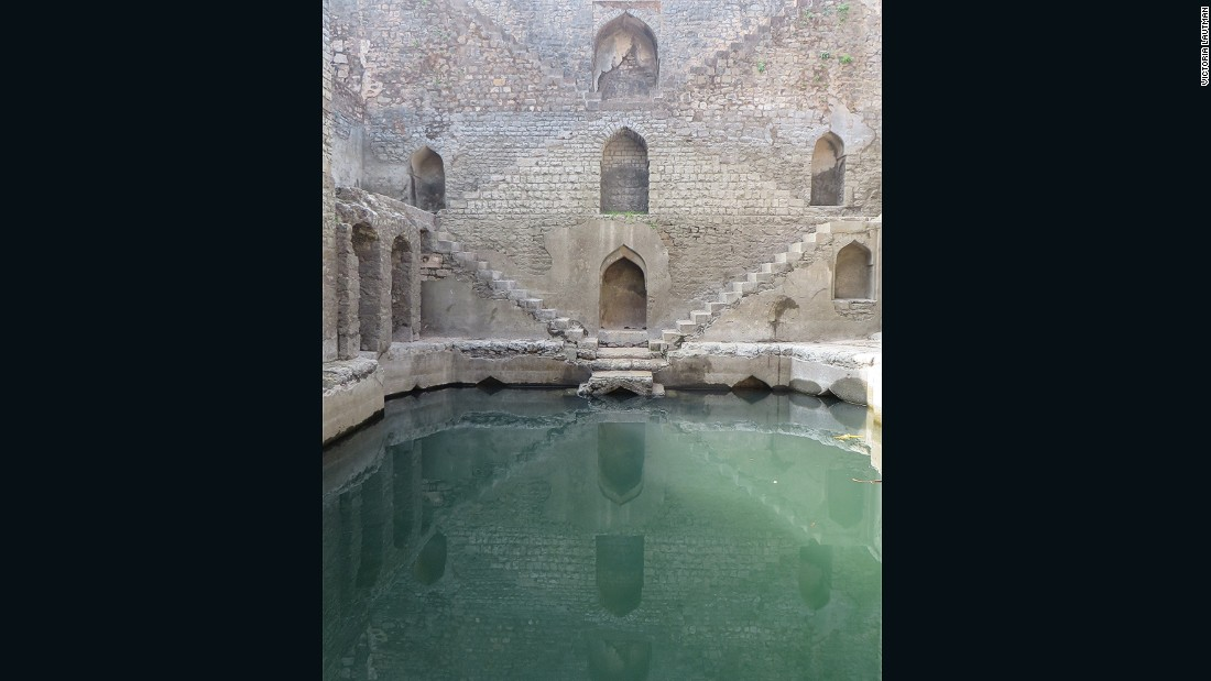 """The fort at Mandu has a number of stepwells, tanks, and sophisticated water-harvesting systems but none as beautiful as Ujala baoli. The picture doesn't show what an odd, asymmetrical structure it really is, or it's sadly dilapidated state."""