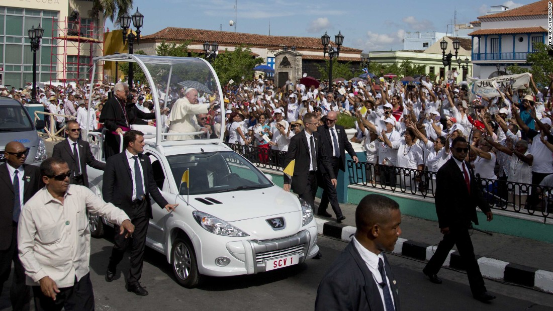 Security surrounds Pope Francis as makes his way to the Metropolitan Cathedral in Santiago, Cuba, on Tuesday, September 22. The Pope arrived in Cuba on Saturday and is scheduled to travel to the United States on Tuesday.