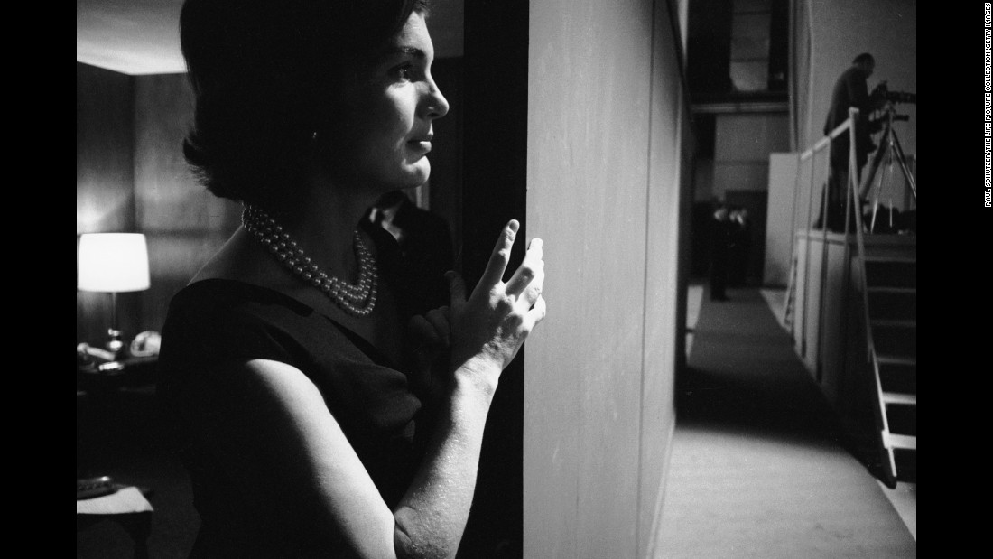 Kennedy's wife, Jacqueline, watches the debate from the wings of the studio.