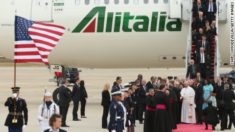 Pope Francis shakes hands with Vice President Joe Biden along with U.S. President Barack Obama, first lady Michelle Obama, and other political and Catholic church leaders after arriving from Cuba September 22, 2015 at Joint Base Andrews, Maryland.