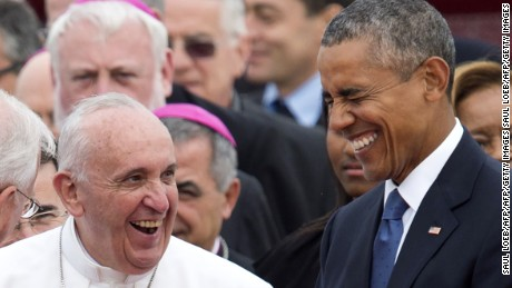 Pope Francis laughs alongside US President Barack Obama upon his arrival at Andrews Air Force Base in Maryland, September 22.