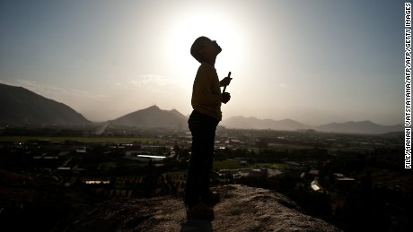 An Afghan boy eyes kites from a hill in Kabul on May 13, 2011.  An Afghan policeman shot dead two soldiers from the US-led NATO coalition, the latest incident of a gunman in uniform targeting foreign personnel, NATO officials said May 13.      AFP PHOTO/ MANAN VATSYAYANA (Photo credit should read MANAN VATSYAYANA/AFP/Getty Images)