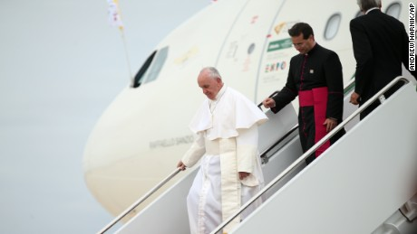 Pope Francis walks down the steps of his plane upon his arrival at Andrews Air Force Base, Md., Tuesday.