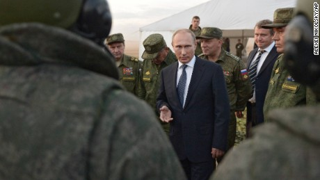 Russian President Vladimir Putin, center, meets with officers after military exercises at Donguz range in Orenburg region, about 1300 kilometers (800 miles) southeast of Moscow, Russia, Saturday, Sept. 19, 2015. Russian President Vladimir Putin on Saturday signaled his intentions to establish a Russian military air base in neighboring Belarus. (Alexei Nikolsky/RIA-Novosti, Kremlin Pool Photo via AP)