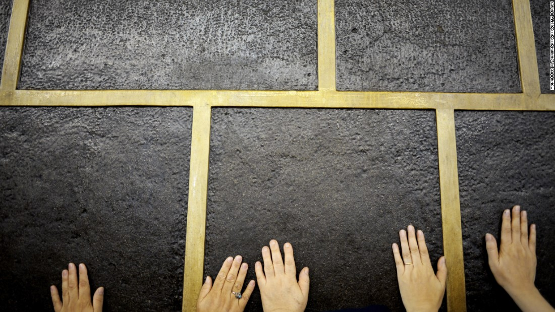 "Muslim pilgrims touch Islam's holiest shrine, the <a href=""https://www.khanacademy.org/humanities/art-islam/beginners-guide-islamic/a/the-kaaba"" target=""_blank"">Kaaba</a>, at the Grand Mosque in Mecca on Monday, September 21. Performing the Hajj is one of the five pillars of Islam."