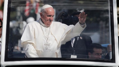 Pope Francis waves to the crowd from the popemobile during a parade in Washington, Wednesday, Sept. 23, 2015, following a state arrival ceremony hosted by President Barack Obama at the White House. (AP Photo/Alex Brandon, Pool)