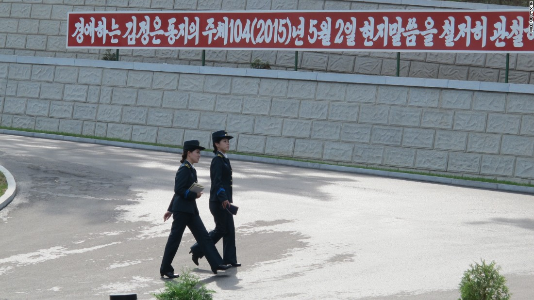 "Two officials walk across the facility. Kim Gun Song (not pictured), who is in charge of the satellite control center, said they ""believe the threat to world security does not come from the peaceful launches of satellites from North Korea, but...from other countries who are trying to use outer space for military purposes."""