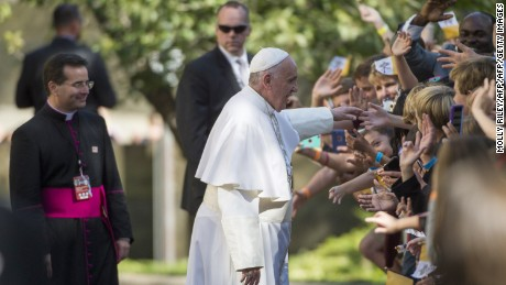 Pope Francis greets well-wishers as he leaves the Apostolic Nunciature to the United States to go to the Basilica of the National Shrine of the Immaculate Conception on September 23, 2015 in Washington, DC.  AFP PHOTO/MOLLY RILEY        (Photo credit should read MOLLY RILEY/AFP/Getty Images)