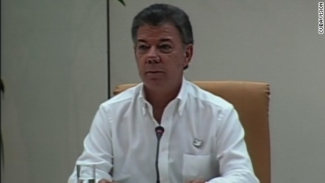 COLOMBIA'S PRESIDENT JUAN MANUEL SANTOS AT PRESSER ANNOUNCING PEACE PROCESS WITH FARC.