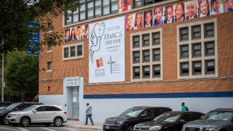 People walk outside Our Lady Queen of Angels School, where Pope Francis is scheduled to visit, Tuesday, Sept. 22, in New York.