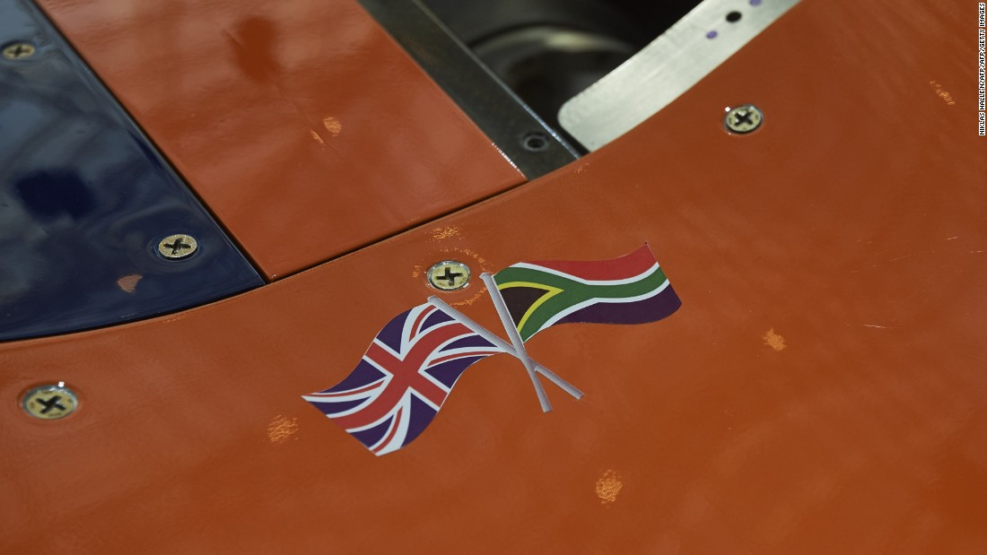The British Union flag and the national flag of South Africa are seen on a panel of the Bloodhound Supersonic Car as it stands on display during a photocall to promote its World Debut, at Canary Wharf in east London.