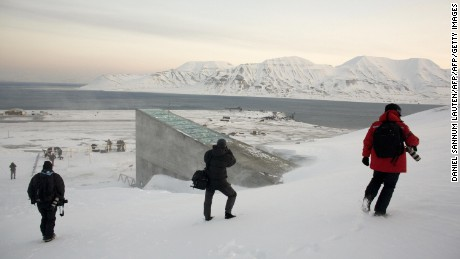 Snow blows off the Svalbard Global Seed Vault as photographers picture it before being inaugurated at sunrise on February 26, 2008 in Longyearbyen. The Global Seed Vault has been built in a mountainside cavern on the island of Svalbard, around 1000 km from the North Pole, to store the world's crop seeds in case of a disaster. AFP PHOTO / DANIEL SANNUM LAUTEN (Photo credit should read DANIEL SANNUM LAUTEN/AFP/Getty Images)
