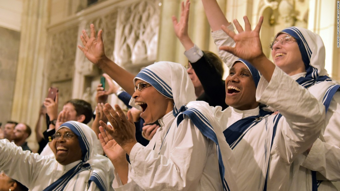 Nuns celebrate at St. Patrick's Cathedral as they wait for the arrival of Pope Francis.