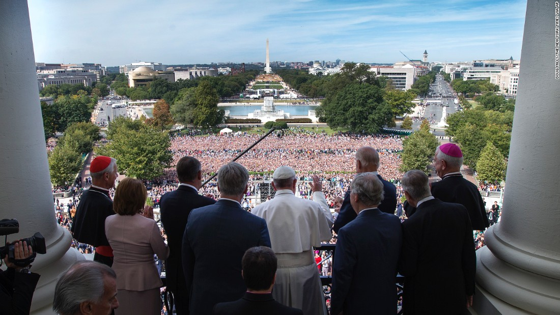 Members of Congress accompany Pope Francis on the Speaker's Balcony on Capitol Hill on September 24.
