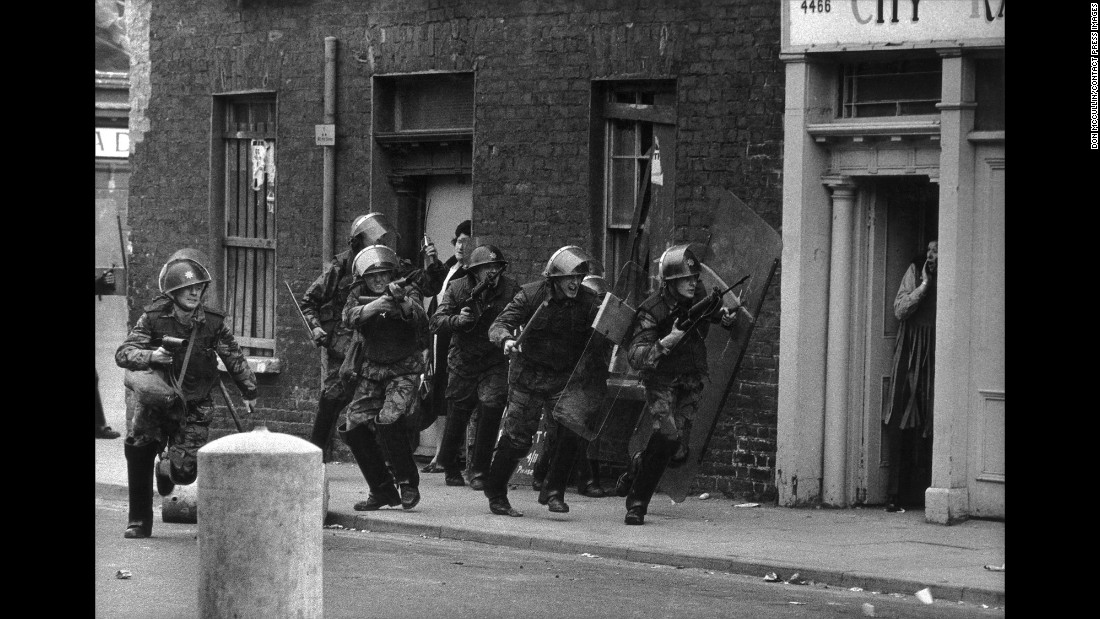 English soldiers charge Catholic youths in Londonderry, Northern Ireland, in 1970.