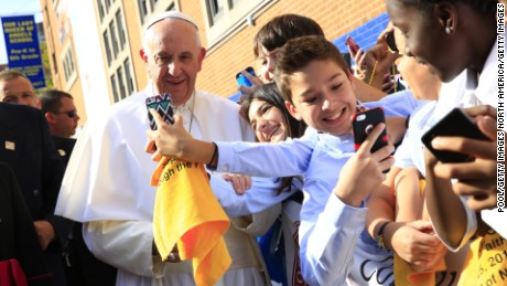 NEW YORK, NY - SEPTEMBER 25:  Pope Francis poses for a photo with guests upon his arrival at Our Lady Queen of Angels School on September 25, 2015 in the East Harlem neighborhood of New York City. Pope Francis is on a six-day trip to the USA, which includes stops in Washington DC, New York and Philadelphia, after a three-day stay in Cuba. (Photo by Eric Thayer-Pool/Getty Images)
