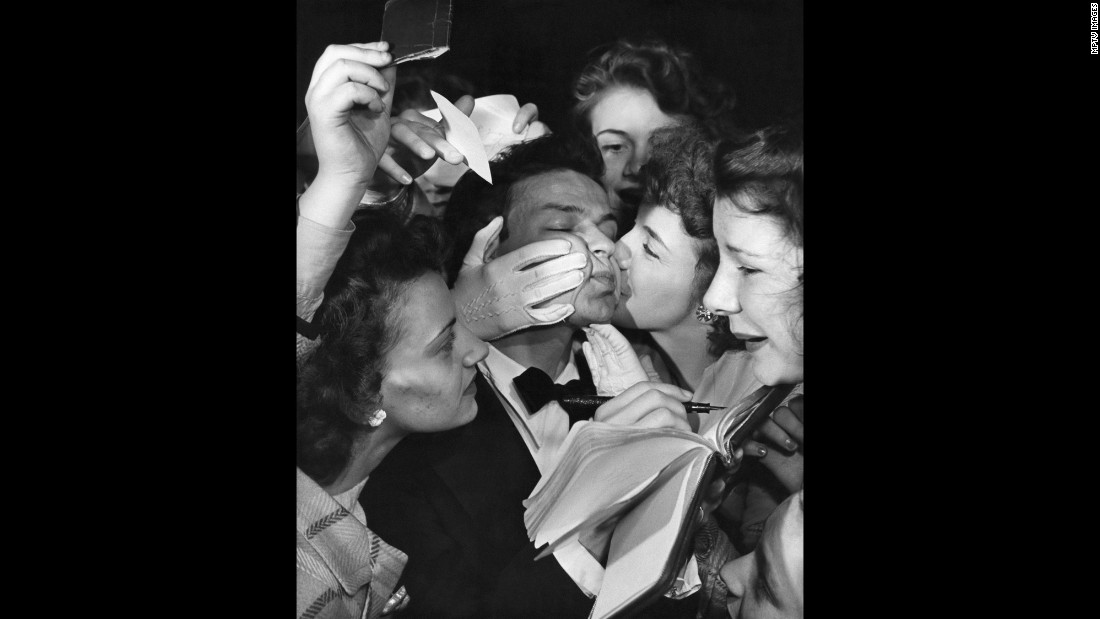 Always blessed with a gorgeous voice, Sinatra also knew how to make the best of it. (He purchased a microphone while still in his teens to practice his sound.) After years with various bands, Sinatra broke out in the 1940s as a teen idol. Here, kissing fans swarm Sinatra for autographs in 1943.