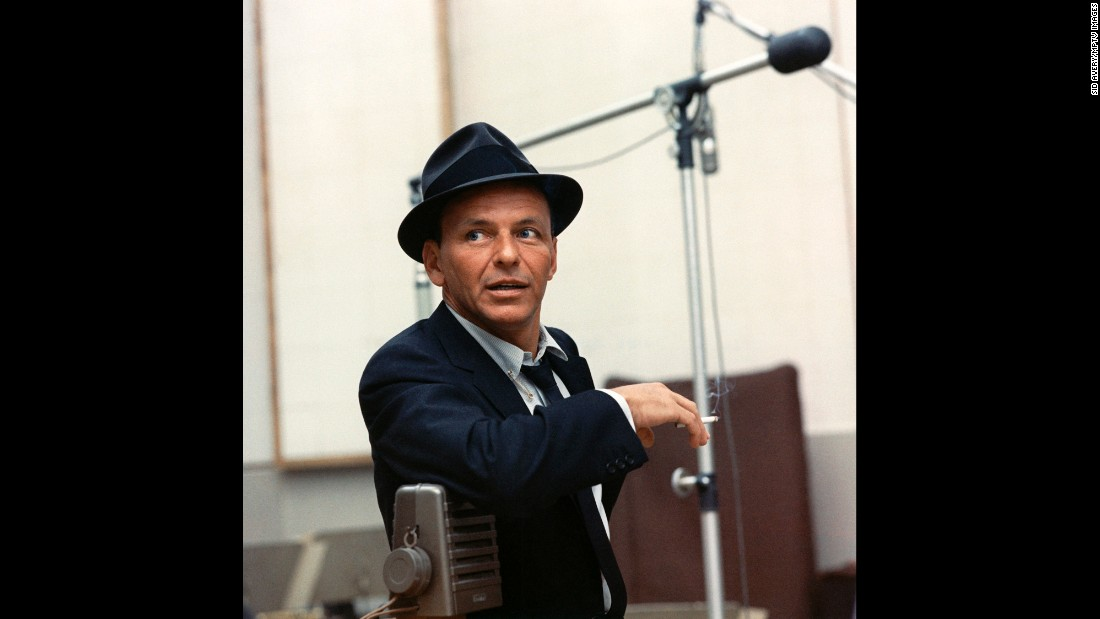 Sinatra also re-established his singing career with a new label, Capitol Records, for which he would record some of his greatest sides. His insouciant look -- loosened tie, tailored jacket, fedora angled just so -- became a trademark.