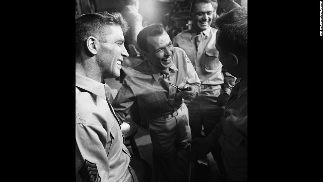 """After his 1940s success, Sinatra's career hit the skids in the early '50s. He was dropped by his movie studio and clashed with his record label, and he had split with his wife to marry actress Ava Gardner. His performance in 1953's """"From Here to Eternity,"""" for which he won an Oscar for best supporting actor, was his comeback. Here, Sinatra shares a much-needed laugh with co-stars Burt Lancaster, Ernest Borgnine and Mickey Shaughnessy in between takes of one of the movie's tensest scenes."""