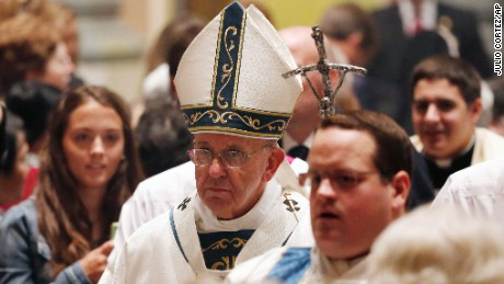 Pope Francis processes toward the altar at Cathedral Basilica of Sts. Peter and Paul during a Mass, Saturday, Sept. 26, 2015, in Philadelphia. (AP Photo/Julio Cortez)
