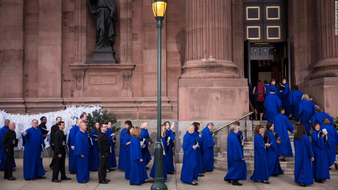 Members of the choir arrive at Cathedral Basilica of Saints Peter and Paul prior to the arrival of Pope Francis on September 26.