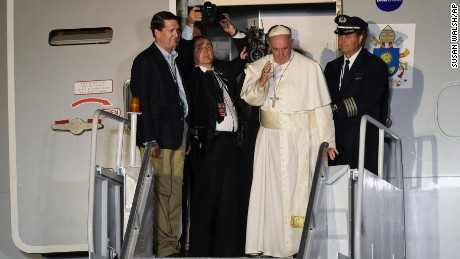 Pope Francis waves from the top of the steps as he prepares to depart Philadelphia International Airport in Philadelphia, Sunday, Sept. 27, 2015, on his way back to Rome. Pope Francis is wrapped up his 10-day trip to Cuba and the United States on Sunday. (AP Photo/Susan Walsh)