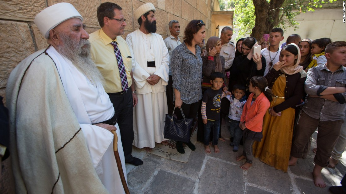 Baba Sheikh, the Yazidi spiritual leader, speaks to Yazidi women and girls who were captives of ISIS before their journey to Germany.