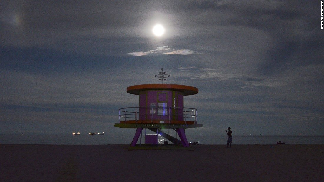 The supermoon rises over Miami Beach.