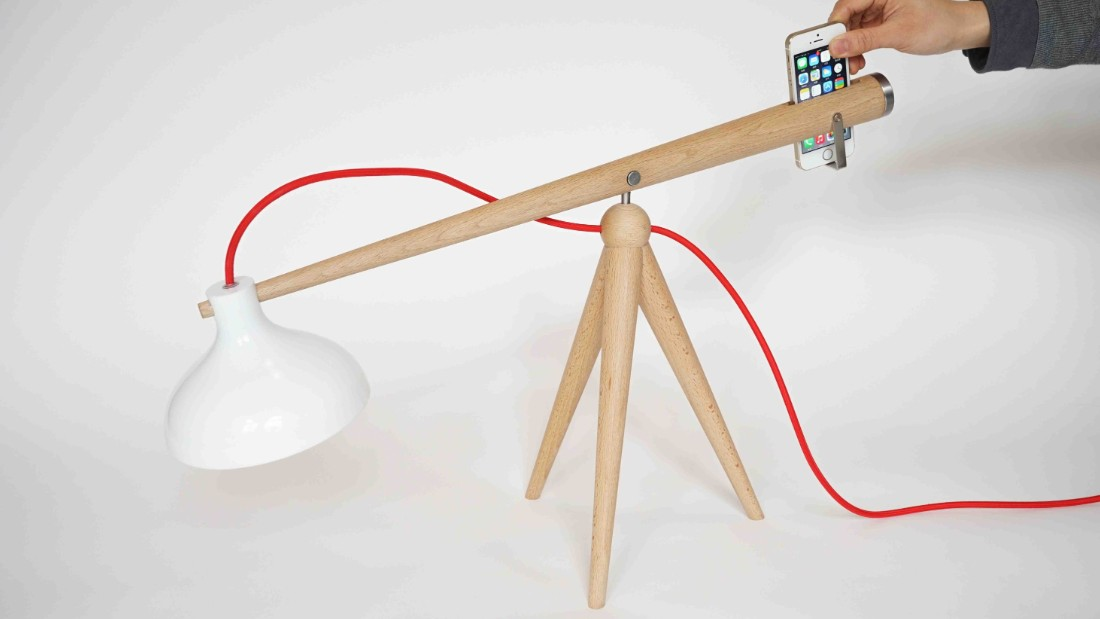 "Berlin-based Chinese design duo <a href=""http://www.yuue-design.com/home/"" target=""_blank"">Yuue</a> showed two lamps at the Hi Shanghai Design event during LDF that combined function with strong concepts. Their Balance lamp (pictured) only works when a smart phone is slipped into one end; their prototype Angry lamp turns itself off in a very huffy way when the surrounding environment is too bright."
