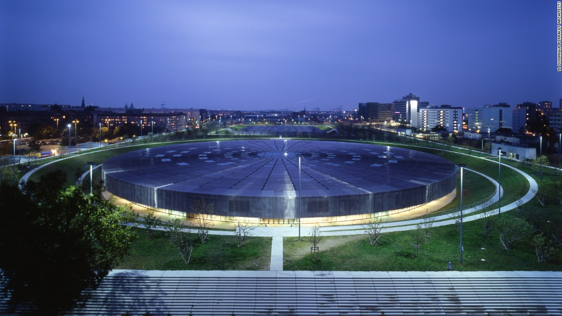 "Berlin's Velodrome and Olympic Swimming Pool continue Perrault's sunken motif, with both structures (the swimming pool is in the background) ""immersed"" and flanked by an apple orchard."