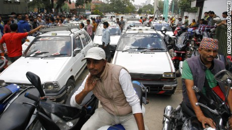 Motorists line up outside a gas station as fuel rations are implemented in Kathmandu on September 28, 2015. Nepal began rationing fuel on September 28 as hundreds of protesters blockaded a key import hub on the Indian border to demand changes to a new constitution they say is unfair. AFP PHOTO        (Photo credit should read STR/AFP/Getty Images)