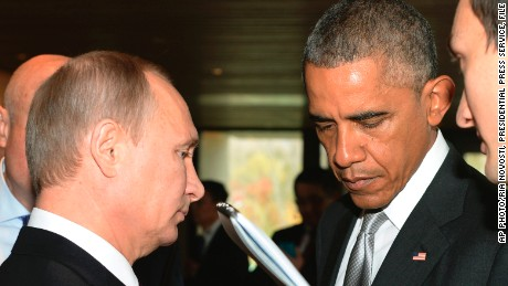 FILE _ This is a Tuesday, Nov. 11, 2014 file photo of Russian President Vladimir Putin, left, and U.S. President Barack Obama, as they talk on the sidelines of the Asia-Pacific Economic Cooperation (APEC) Summit  in Beijing.  Vladimir Putin's spokesman said Thursday Sept. 24, 2015, that  the Russian president will meet with President Barack Obama on Monday. Putin is to speak to the United Nations General Assembly that day. It's not clear whether the meeting with Obama will take place before or after the speech.  (AP Photo/RIA Novosti, Presidential Press Service, File)