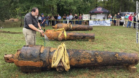 "In this photo provided by the University of South Carolina, University of South Carolina archaeologist and state archaeologist Jon Leader washes and inspects one of the three Civil War cannons pulled from the Pee Dee River on Tuesday, Sept. 29, 2015, in Mars Bluff, S.C. The three cannons were dumped in the river by Confederate forces from the gunboat CSS Pee Dee in 1865 in order to keep them from falling into the hands of Union forces. (Margaret ""Peggy"" Ryan Binette/University of South Carolina via AP)"