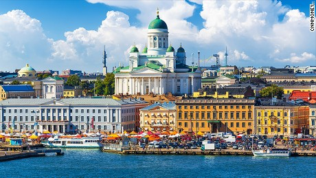 Crowds gather at a popular waterfront area in Helsinki, Finland.